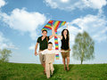 Father, mother and child on grass with kite Royalty Free Stock Image