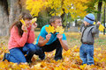 Father, mother and son happy family in autumn, yellow leaves Royalty Free Stock Photo