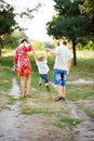 Father mother and son walking outdoors happy family concept rear view summer holiday Royalty Free Stock Photo