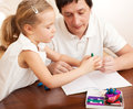 Father play with child at home family molded from clay toys Royalty Free Stock Photography