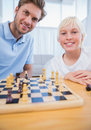 Father playing chess with his little boy in the living room Royalty Free Stock Photo