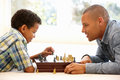 Father playing chess with son Royalty Free Stock Photo