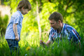 Father playing with his small son in the grass nature Royalty Free Stock Photography