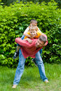 Father playing with two children Stock Images