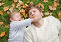 Father plays with the child autumn