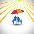 Father protects family from hot sun with umbrella Royalty Free Stock Image
