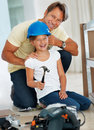 Father putting on an helmet on his daughter Royalty Free Stock Photos