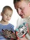 Father read book son Stock Images