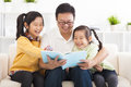 father read the book to children Royalty Free Stock Photo