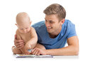 Father reading a book to son baby Royalty Free Stock Photo