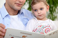 Father reading story to his daughter Stock Images
