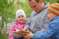Father reads book for kids, focus on little girl Royalty Free Stock Photo