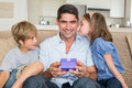 Father receiving gift from loving children Royalty Free Stock Photo