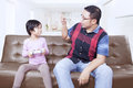 Father scolding his daughter at home Royalty Free Stock Photo