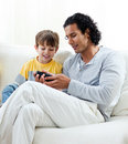 Father showing a box to his son Royalty Free Stock Image