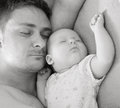 Father sleep with baby his Royalty Free Stock Image