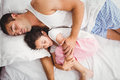 Father sleeping with daughter on bed at home Royalty Free Stock Photo