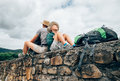 Father and son backpacker traveler rest together sitting on old Royalty Free Stock Photo