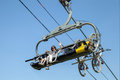 A father with son and bikes on chair lift Royalty Free Stock Photo