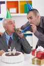 Father and son on birthday senior celebrating th with his Royalty Free Stock Photos