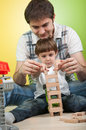 image photo : Father and son building a toy tower