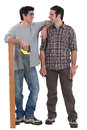 Father and son carpentry team working together Royalty Free Stock Photos