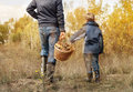 Father and son carry full basket of mushrooms Royalty Free Stock Photo