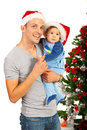Father and son celebrate christmas baby first looking away together Royalty Free Stock Photography