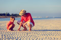 Father and son collecting seashells on summer tropical beach Stock Photography