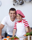 Father and son cooking a salad Royalty Free Stock Images