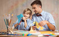 Father and son cutting paper Royalty Free Stock Photo