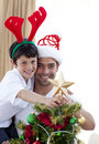 Father and son decorating Christmas tree Stock Photos