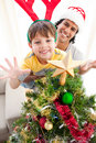 Father and son decorating a Christmas tree Royalty Free Stock Photo