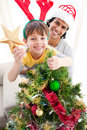 Father and son decorating a Christmas tree Stock Image