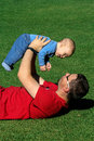 A father and a son enjoy happy time baby in the park Royalty Free Stock Photo
