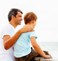 Father and son enjoying the serene beach view Royalty Free Stock Photography