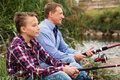 stock image of  Father and son fishing on river