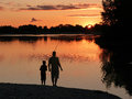 Father and son fishing at sunset Royalty Free Stock Photo