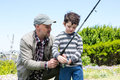 Father and son fishing together Royalty Free Stock Photo