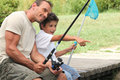 Father and son fishing on a trip Royalty Free Stock Photo