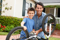 Father and son fixing bike Royalty Free Stock Photography