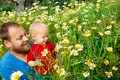 Father and son in flowers Royalty Free Stock Photos