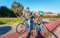 Father and son giving five by success riding Royalty Free Stock Photo