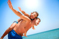 Father and son having fun at the beach vacation concept Royalty Free Stock Photos