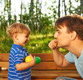 Father and son having fun outdoors Stock Image