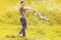 Father and son having fun outdoors in sunny summer Royalty Free Stock Photo