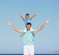 Father and son having fun on... Royalty Free Stock Photo
