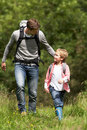 Father and son hiking in countryside walking towards camera Stock Image