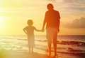 Father and son holding hands at sunset Royalty Free Stock Photo