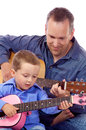 Father son holding their guitar Stock Photos